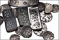 Mix of short punch-marked bent bars, long ones, Gandharan coins and Mauryan punch-marked coins.jpg