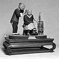 Model of Chinese barber cleaning ears of client. Wellcome L0006338.jpg