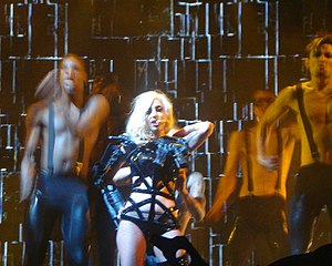 "Poker Face (Lady Gaga song) - Gaga performing ""Poker Face"" on The Monster Ball Tour, wearing a dress made of guns"