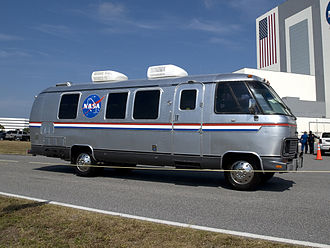 Airstream - The Astrovan drives in front of the Vehicle Assembly Building.