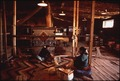 NAVAJO WEAVERS AT HUBBEL TRADING POST, THE FIRST SUCH POST ON THE NAVAJO RESERVATION - NARA - 544431.tif