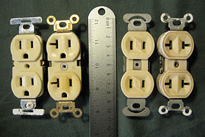 NEMA connector - Common North American 125 volt receptacles. All accept a 1-15P plug; the two on the left also accept 5-15P plugs. The NEMA 5-15R device on the far left is most common; the designs on the right are typically seen in older buildings.