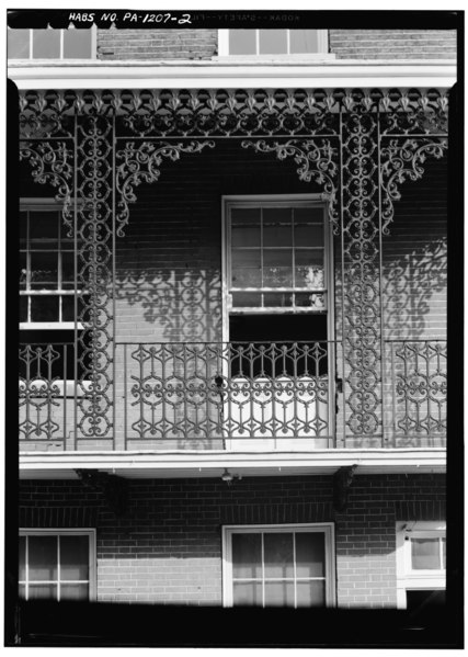 File north front iron work of second story balcony for Second story balcony