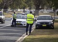 NSW Police Force highway patrol officers conducting random breath testing on Travers St.jpg