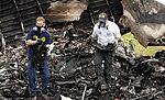 NTSB investigators remove the recorders from UPS 1354 (9518908718).jpg