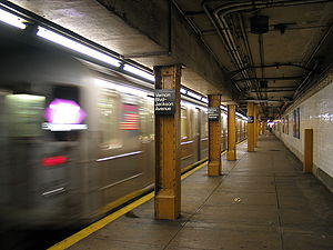 Vernon Boulevard–Jackson Avenue (IRT Flushing Line) - A <7> Express train speeds out of Vernon Boulevard–Jackson Avenue station.