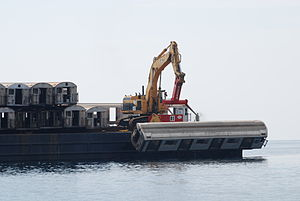 Artificial reef - Retired subway cars on a barge before being sunk to form an artificial reef.