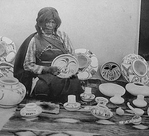 Nampeyo, Hopi pottery maker, seated, with examples of her work, cropped.jpg
