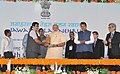 Narendra Modi being presented a memento by the Union Minister for Road Transport & Highways and Shipping, Shri Nitin Gadkari, at the foundation stone laying ceremony for 4th Container Terminal, at J.N Port.jpg