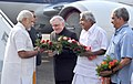 Narendra Modi being received by the Governor of Kerala, Justice (Retd.) P. Sathasivam, the Chief Minister of Kerala, Shri Oommen Chandy and the Union Minister for Defence, Shri Manohar Parrikar, on his arrival in Kochi.jpg