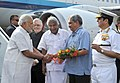 Narendra Modi being received by the Governor of Kerala, Justice (Retd.) P. Sathasivam, the Chief Minister of Kerala, Shri Oommen Chandy and the Union Minister for Defence, Shri Manohar Parrikar.jpg