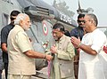 Narendra Modi being welcomed by the Minister of State for Textiles (IC), Parliamentary Affairs, Water Resources, River Development and Ganga Rejuvenation, Shri Santosh Kumar Gangwar.jpg