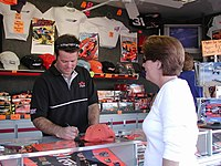 Robby Gordon signing autographs at his souvenir trailer, a very common sight during most NASCAR Nextel Cup Weekends