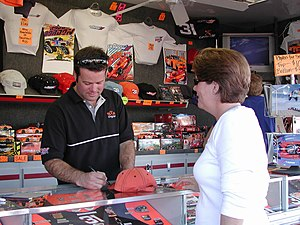 Robby Gordon - Gordon signing autographs at his souvenir trailer, a very common sight during most NASCAR weekends