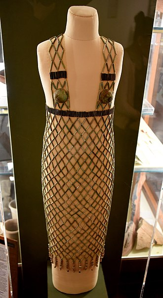 Clothing in ancient Egypt - Network dress. Faience, blue and black cylinder beads, 2 breast caps and 2 strings of Mitra beads. 5th Dynasty. From burial 978 at Qau (Tjebu), Egypt. The Petrie Museum of Egyptian Archaeology, London