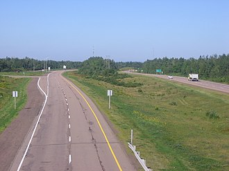 New Brunswick Route 15 - Route 15 as it passes outside Shediac, New Brunswick at Exit 37. The image shows the wide median that the Province of New Brunswick generally employs on its divided highways. This portion of highway was completed about 1970.