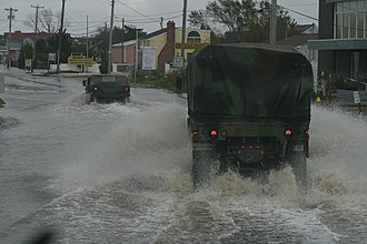 Long Beach Island - New Jersey National Guard vehicles navigating floodwaters along Route 72 in Ship Bottom during Hurricane Sandy