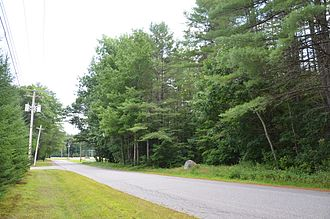 Norridgewock - The site of the Norridgewock Native American village in Maine, in what is now Madison. The rock at the side of the road bears a plaque marking the site.