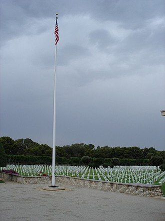 North Africa American Cemetery and Memorial - The flagpole and the cemetery