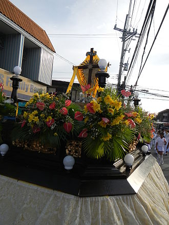 Flores de Mayo - A replica of the True Cross in solemn procession during the Flores de Mayo in Noveleta, Cavite