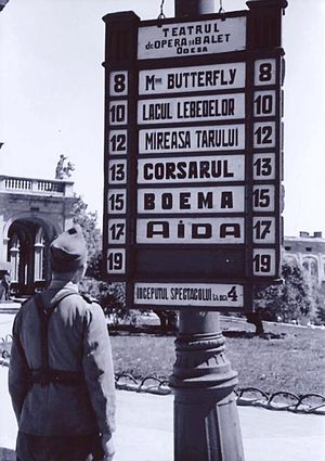 Transnistria Governorate - Romanian soldier reading an opera house advert in Odessa, 1942.