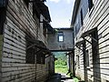 Old bridge between two colonial warehouse buildings in Apia - panoramio.jpg