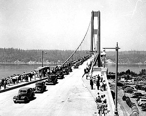 "Washington State Route 16 - The original Tacoma Narrows Bridge, also known by its nickname of ""Galloping Gertie"", during its opening on July 1, 1940."
