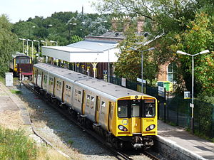 Ormskirk railway station - Merseyrail electric and Northern diesel trains wait at the same platform. Note the trains are separated by a buffer
