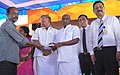P. Radhakrishnan giving away sanctioned documents to the beneficiaries of MUDRA Scheme, at the 'MODI FEST' (Making of Developed India Festival), in Chennai (1).jpg