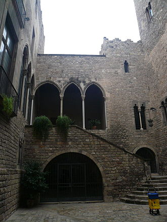Catalan Gothic - View of a typical courtyard with stairs in the palace Requesens, located in the Gothic Quarter of Barcelona.