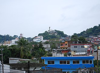 Papantla - Overview of Papantla with the Monument to the Volador in the background