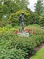 Peonies and statue of gardener, Kew Gardens - geograph.org.uk - 176618.jpg