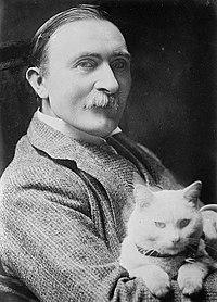Philip Burne-Jones holding cat.jpg