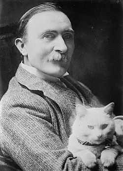 Philip Burne-Jones holding cat.jpg