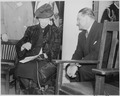 Photograph of Eleanor Roosevelt with a man of uncertain identity (probably Secretary of the Interior Julius Krug) on... - NARA - 199353.tif