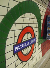 Piccadilly Circus tube stn Piccadilly roundel.JPG