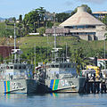 Police boats and parliament house Honiara.jpg