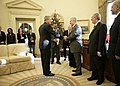 President George W. Bush shakes the hand of Vice President Tariq al-Hashemi of Iraq as they near the end of their Oval Office.jpg