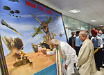 Prime Minister Narendra Modi signs a painting at Iron Fist 2016 at Pokhran, Rajasthan.jpg