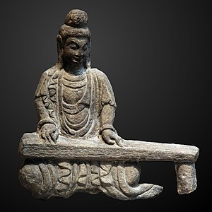 Guqin - Rock carving of a bodhisattva playing a guqin, found in Shanxi, Northern Wei Dynasty (386–534).