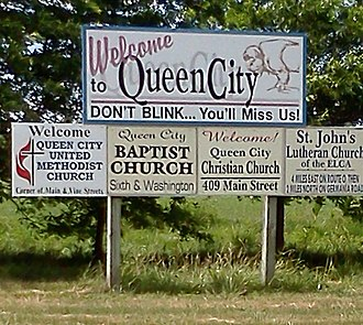 Queen City, Missouri - Welcome sign, using humor to point out the town's small size.