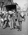 RAF recruits collect their kit bags from a lorry at the RAF Aircrew Reception Centre, Regent's Park, London, 27 April 1942. CH10989.jpg