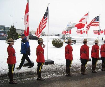 RCMP honour guard waits fo Air Force One in Ottawa