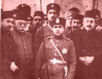 Reza Kahn behind Ahmad Shah