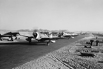 History of aviation in Bangladesh - Thunderbolts of No. 30 Squadron RAF taxiing past a line of Hawker Hurricane Mark IICs, at Cox's Bazar