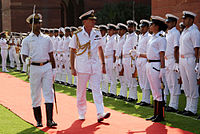 Royal Navy Admiral George Zambellas inspecting a guard of honour at South Block lawns, New Delhi.JPG