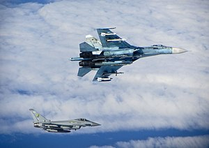 Baltic Air Policing - Royal Air Force Eurofighter Typhoon (bottom) escorts Russian Air Force Su-27 ''Flanker'' (top) over the Baltic in June 2014