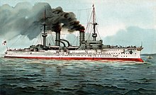 A large warship with white hull and dark gray superstructure, thick black smoke belching from its two tall smokestacks