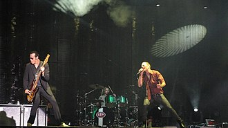 2008 Stone Temple Pilots Reunion Tour - STP onstage (from left to right: Robert DeLeo, Eric Kretz, and Scott Weiland)
