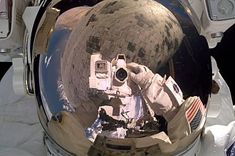 STS-114 Steve Robinson turns the camera on himself during his repair job.jpg